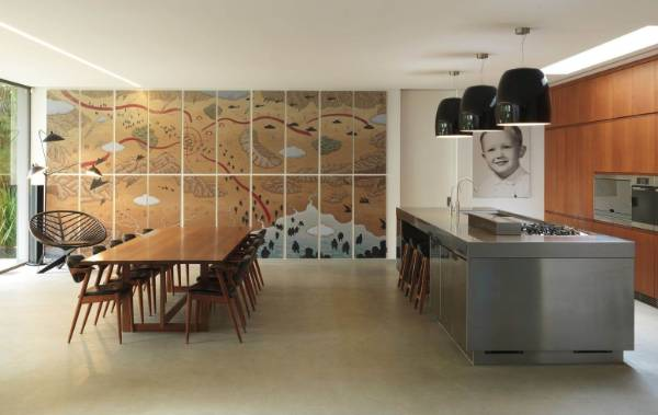 The stunning kitchen incorporates a vast mural along one wall.