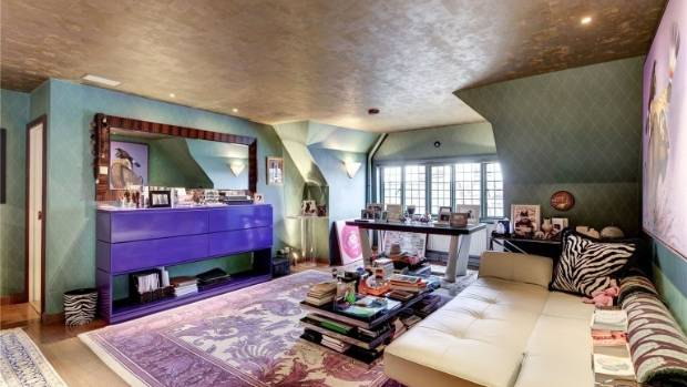The second living room/guest room is punctuated by an array of rich purples.
