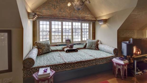 A leopard print window seat just begs someone to take a nap on it.