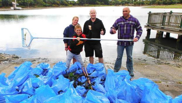 Sarah Gibbison, Matt Pollock, Steven Beddie and his son Diontae Marsh Beddie pitched in to help clean out Aotea Lagoon ...