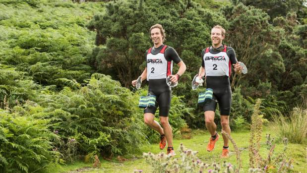 Hamish Cropper, left, and Alan Scott, compete in the BrecaButtermere swimrun race in the United Kingdom.