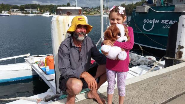 Alan, Que and 'Dog' Langdon at Ulladulla Harbour with the catamaran in which they travelled for 27 days across the ...