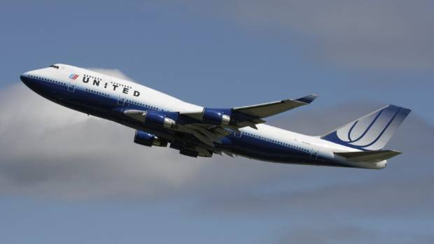 United Airlines Boeing 747-400, aircraft, climbing on departure, into the sky.