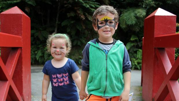 Emily Symon, 3, and her big brother Oliver Symon, 6, took little steps through the park so she could keep up to take in ...