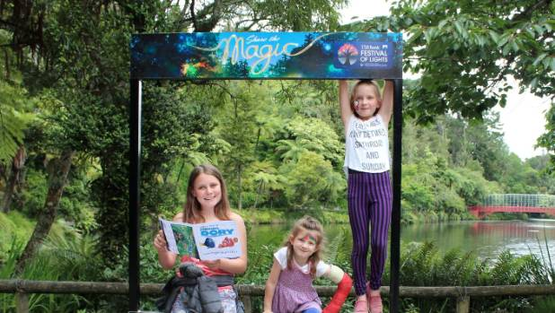Bethanie Lovell deciphering clues with Sasha Ligget, 5, and sister Briar Lovell, 8, at the Festival of Lights Summer ...