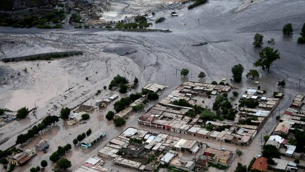 A road covered in mud after a landslide caused by a storm in the village of Volcan, Argentina.