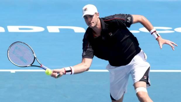 John Isner heads to the net during his quarterfinal against fellow American Steve Johnson.