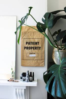 The 'Patient Property' bag was given to Tuck when he had surgery on a broken finger. He decided after that it would also ...