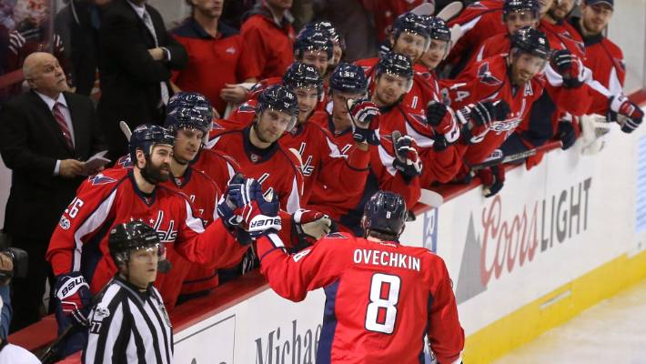 a439b0763aa Alex Ovechkin gets fist-bumps from his Washington Capitals teammates after  scoring the game s opening