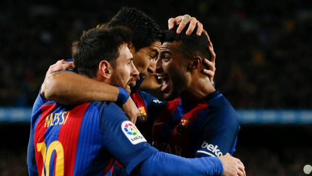 Barcelona's Luis Suarez (centre) celebrates after scoring his first goal with teammates Lionel Messi (left) and Rafinha.