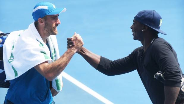 USA's Steve Johnson shook hands with Yankees baseball player Didi Gregorius after his quarterfinal singles win at the ...