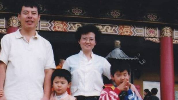 "Min ""Norman"" Lin with his wife Lily Lin and their two sons Henry and Terry."