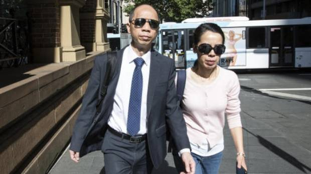 Robert Xie and his wife Kathy Lin arrive at the Supreme Court in Sydney, Australia.