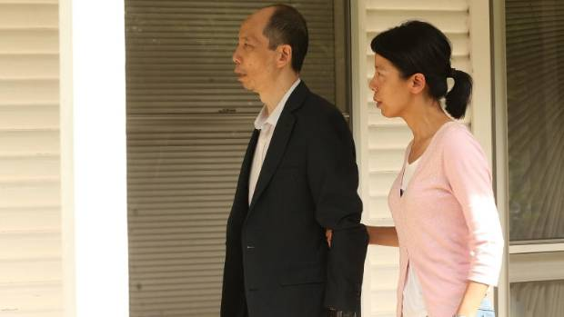 Robert Xie arrives home with wife Kathy Lin after being granted bail on 11 Dec 2015.