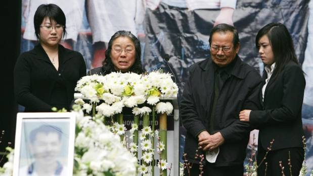 Grieving family members of the late Lin family speak during the public funeral  on 8 Aug 2009.