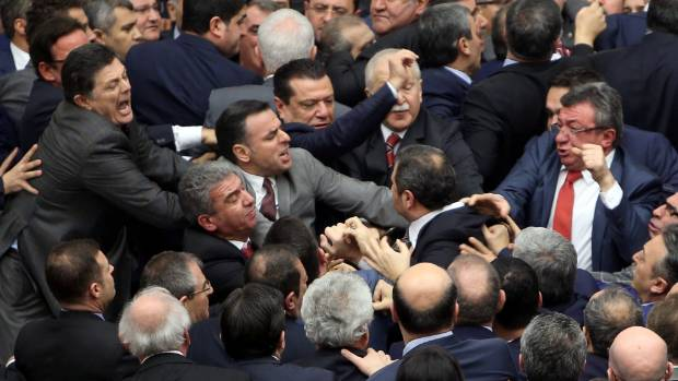 Lawmakers from ruling AK Party and the main opposition Republican People's Party (CHP) scuffle during a debate.
