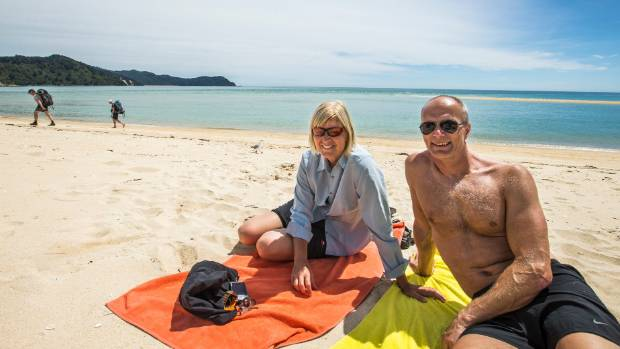 Visitors Maggie Ivarsson and Gerry Engstrom enjoy the beach.