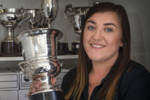 Taranaki Federated Farmers office manager Jessie Waite with the Richmond Trophy, awarded for Meat and Wool Farmer of the ...
