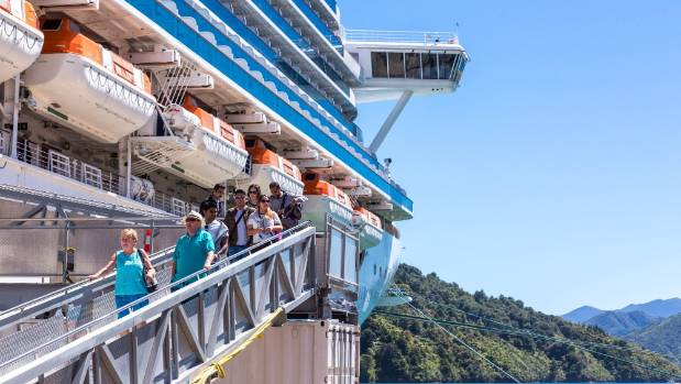 Passengers disembark the Emerald Princess in Picton, one week after the November 14 earthquake.