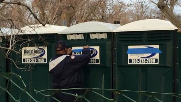 'Don's Johns' name on inauguration porta-potties found covered with tape