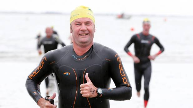 Tim Jackson crossing the finish line in the Timaru ocean swim.