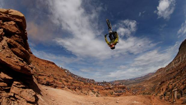 Kelly McGarr goes over a jump during the finals of the Red Bull Rampage on October 16, 2015 in Virgin, Utah.