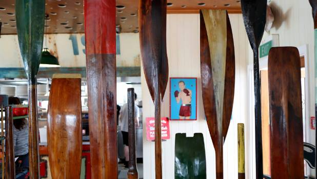 A 'wall' of vintage oars is a cool way to create separate zones.