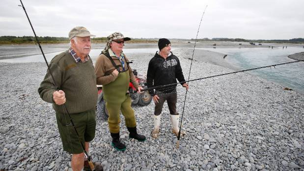 Peter Ritchie, Bob Nortimer and Graeme Dubar at the river mouth last week. Ritchie said there are very few fishermen ...