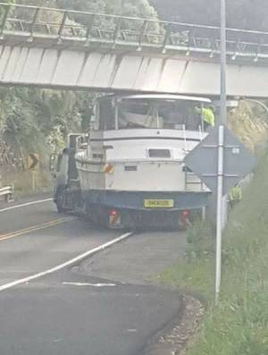 A truck carrying a boat on its trailer got stuck under a rail bridge on SH1, just south of Waikanae, on Monday evening.