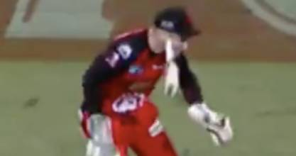 The bat makes contact with Peter Nevill's cheekbone.