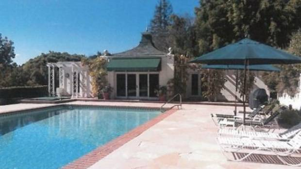 The house has a large pool and original pool cabana. There is also a tennis court.
