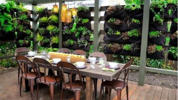 Use living walls to add Pinterest level elegance to outdoor dining.