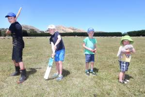 Ward cricketers, from left, Kyle Bailey, 11, with James, 7, Harrison, 5 and Grayson Litchfield, 2, ready to swing the ...