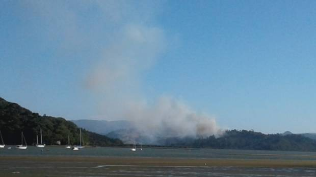 Fire crews including the rural fire brigade and two helicopters carrying monsoon buckets have fought the blaze near ...