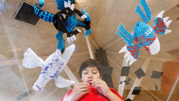 Marz creates hundreds of carefully folded cones to create three-dimensional creations, such as Pokemon character.