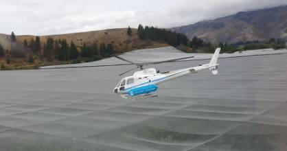 A helicopter is used to dry cherries at New Zealand Cherry Corp's orchard in Cromwell.