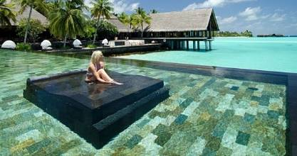 Relax at the pool at One&Only Reethi Rah in Maldives.