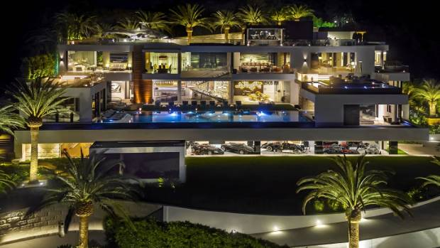 By night, it could be mistaken for a grand resort - there are even palm trees on the roof.