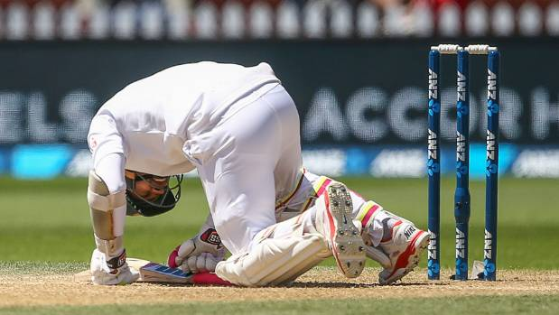 Mushfiqur Rahim, of Bangladesh, goes to ground after being struck in the helmet by a delivery from Tim Southee at Basin ...