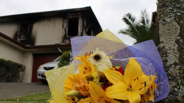 Flowers were left outside the home on Plantation Ave following the fatal blaze.