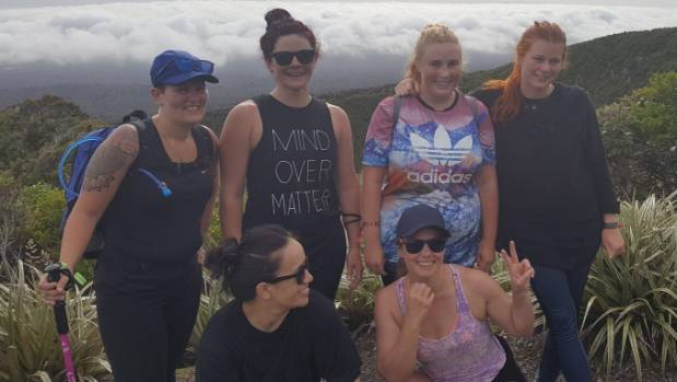 Back left: Michelle O'Doherty, Sheree Todd, and two Swedish tourists behind Puhi Brown and Teri Coxhead on the Pouakai ...