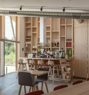 Natural timber-lined interiors are in keeping with the surroundings.