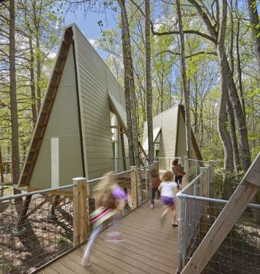 Camp Graham in North Carolina is a Girl Scout camp designed by Weinstein Friedlein Architects. The huts are set on poles ...