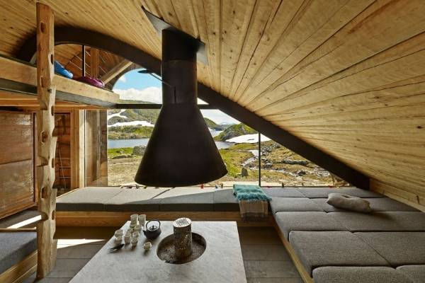 The ceiling follows the curved shape of the roofline, echoing the form of the mountains beyond.