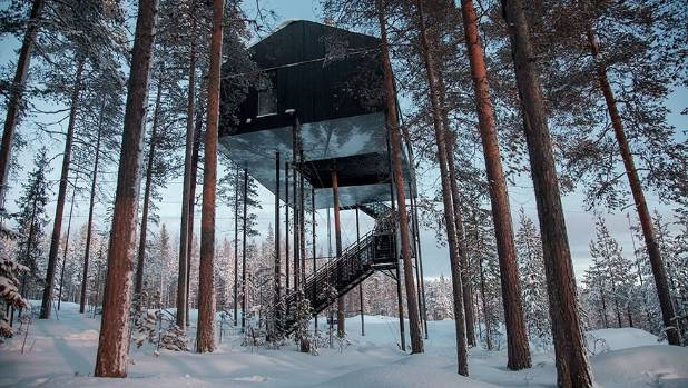 You can lie back and watch the Northern Lights from this treehouse guest cabin in Lapland, called The 7th Room.