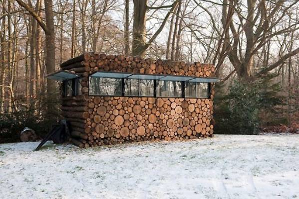 Designed by Piet Hein Eek as a log house on wheels, this cabin in the Netherlands is a study for music-entertainer Hans ...