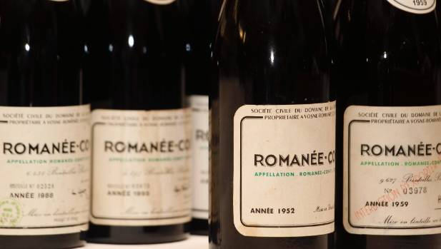 Following tastings of vintages of Romanee-Conti, an employee will put an X through the label of any open bottles so no ...