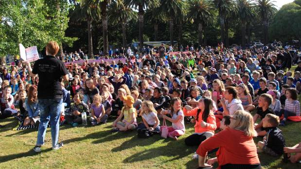 A large crowd of children and parents listen to city librarian Rhonda Chenery read at the Esplanade.