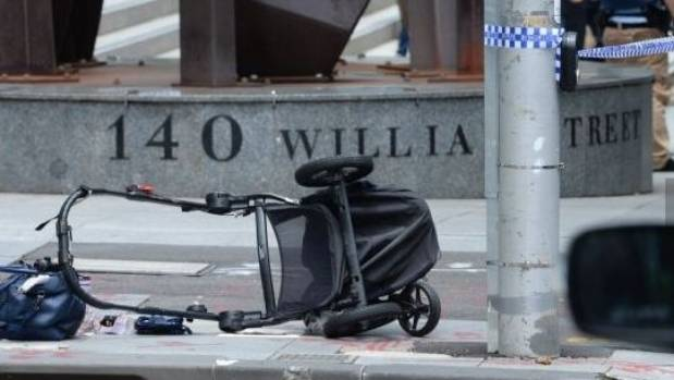 An upturned pram lies amid the carnage in Melbourne.