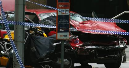 The wreckage of the car used in the street rampage sits inside a police cordon in Bourke Street mall.